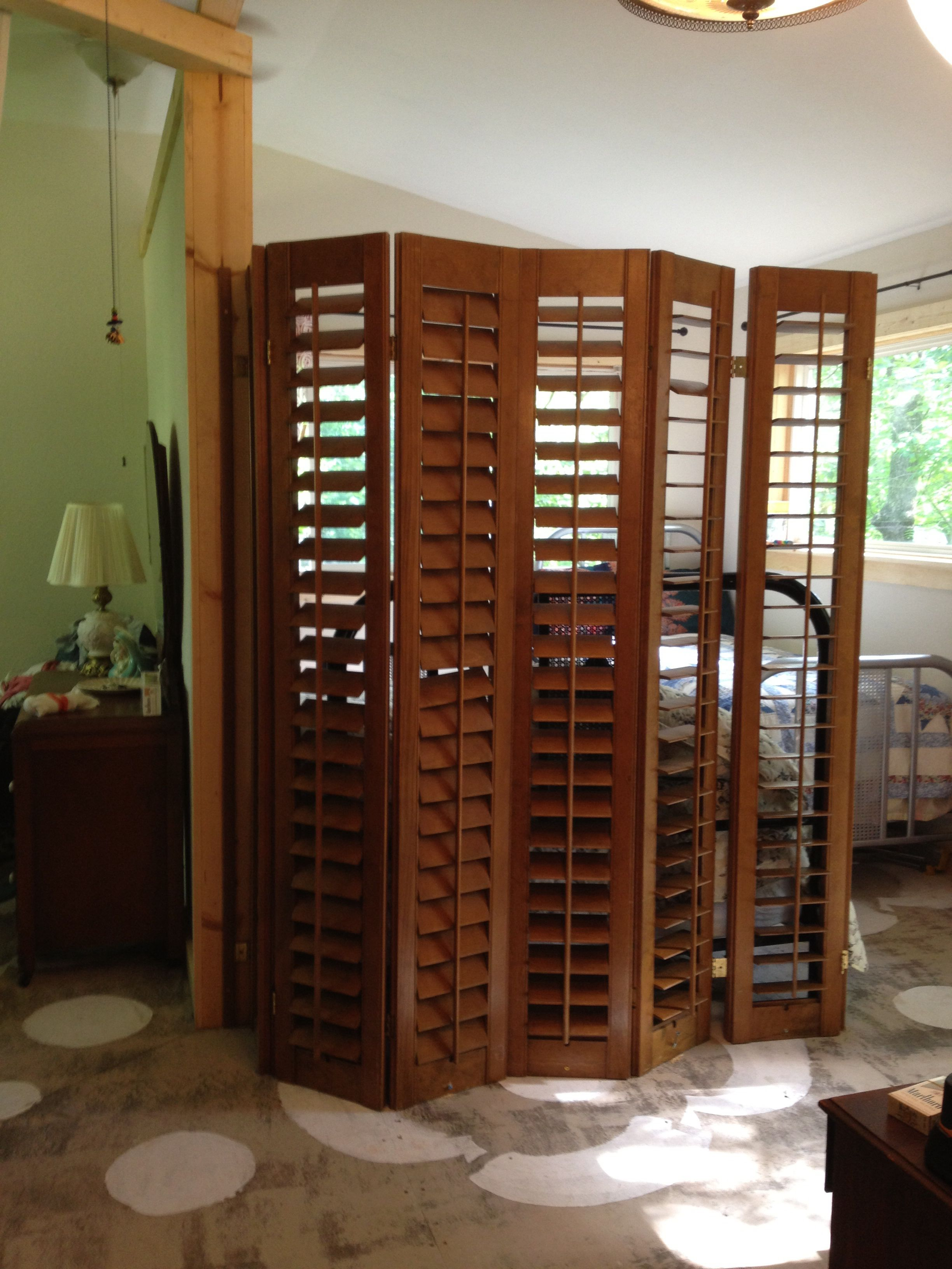 Plantation Shutters Repurposed As A Room Divider