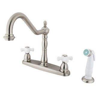 View the Kingston Brass KB175.PX Heritage Centerset Kitchen Faucet with Porcelain Cross Handles and Side Spray at FaucetDirect.com.