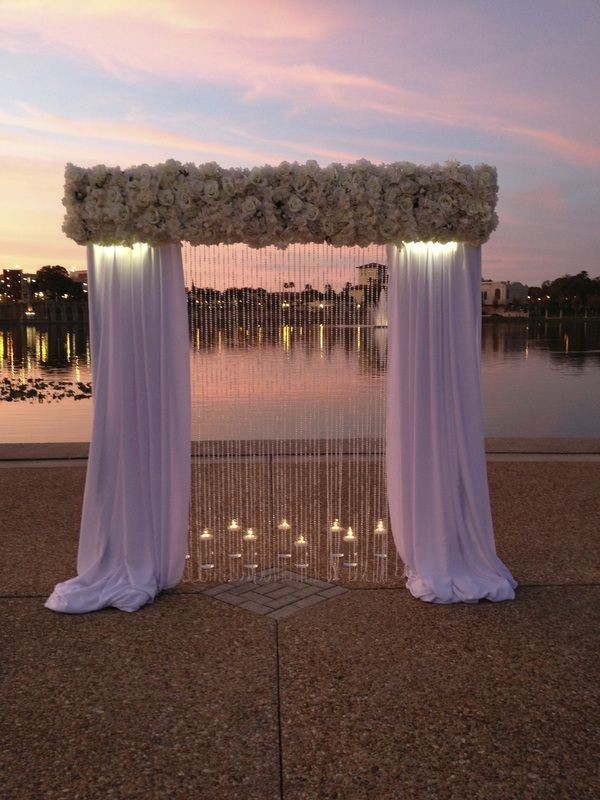 Draping for first gazebo at entrance of walkway- not so many flowers- but a thin all white layer covering the wood (no brown/wood showing) Wedding Ceremony Flowers