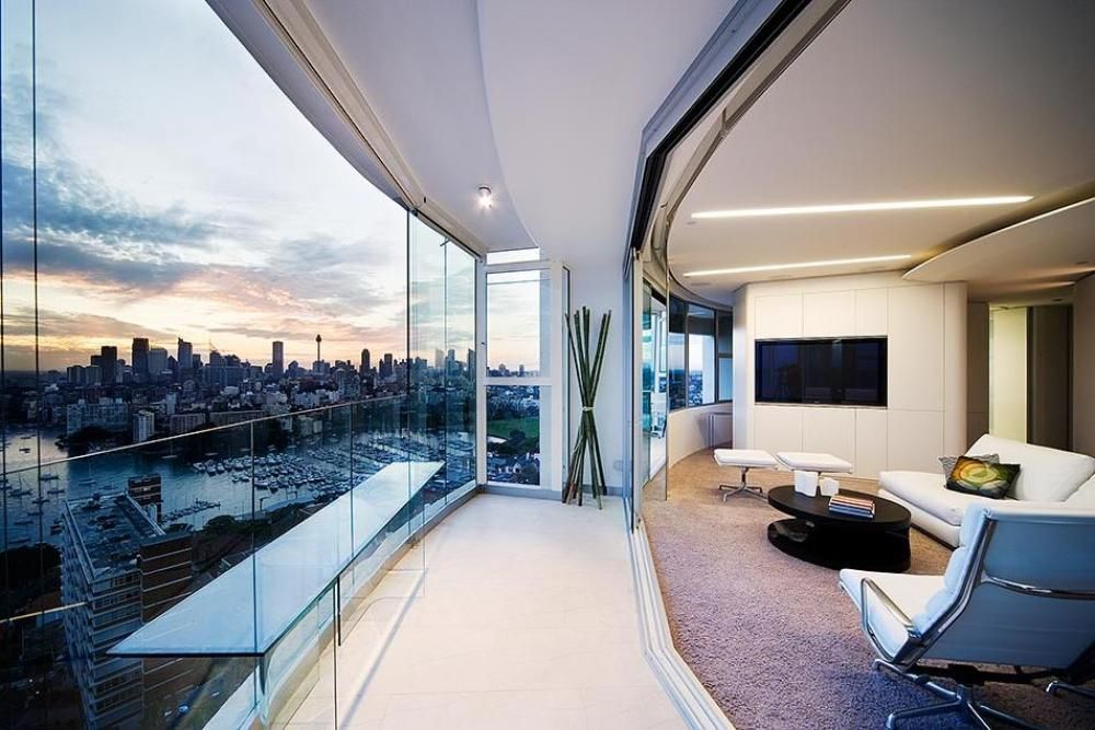 Glass wall apartment overlooking the water and