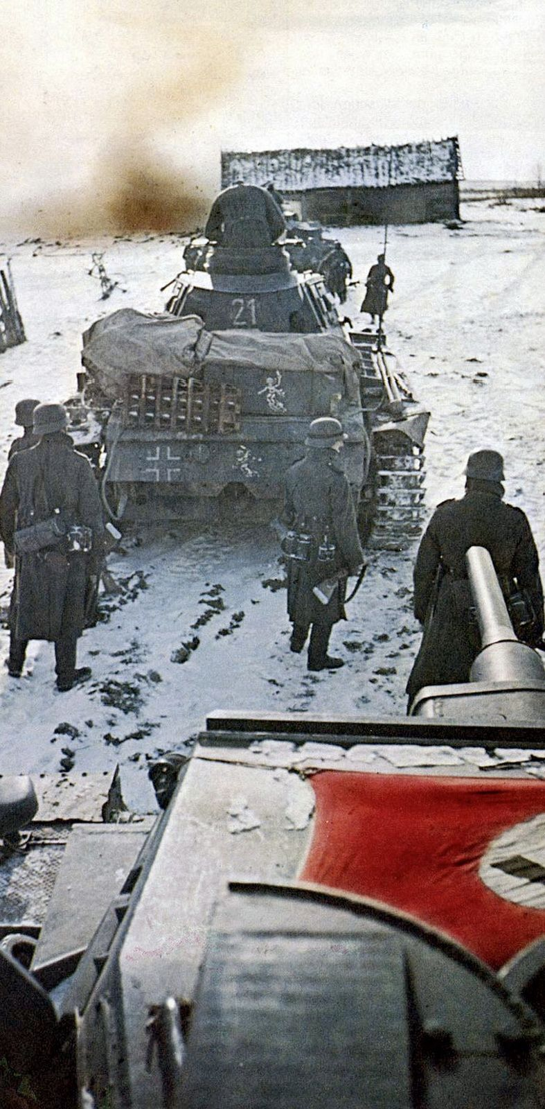 Panzerkampfwagen III Ausf.H tanks of 11. Panzer-Division enter a Soviet village. The 11. Panzer-Division fought in Operation Barbarossa from June 22, 1941 to June 1944, then the division was transferred to France. It suffered heavy losses in both the Eastern and Western Fronts and was rebuilt several times with personnel and equipment from other units. 11th Panzer surrendered to the Americans in April 1945. Note the equipment covered by tarps and the extra track on the Panzer III