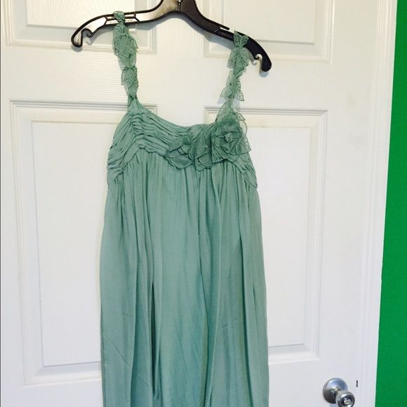 Gold Hawk Silk Dress This is a beautiful mint teal silk dress. I only wore this one time and had it dry cleaned.  This dress is fully lined and has beautiful lace work on chest line and straps. Please ask any questions. Golden Hawk Dresses