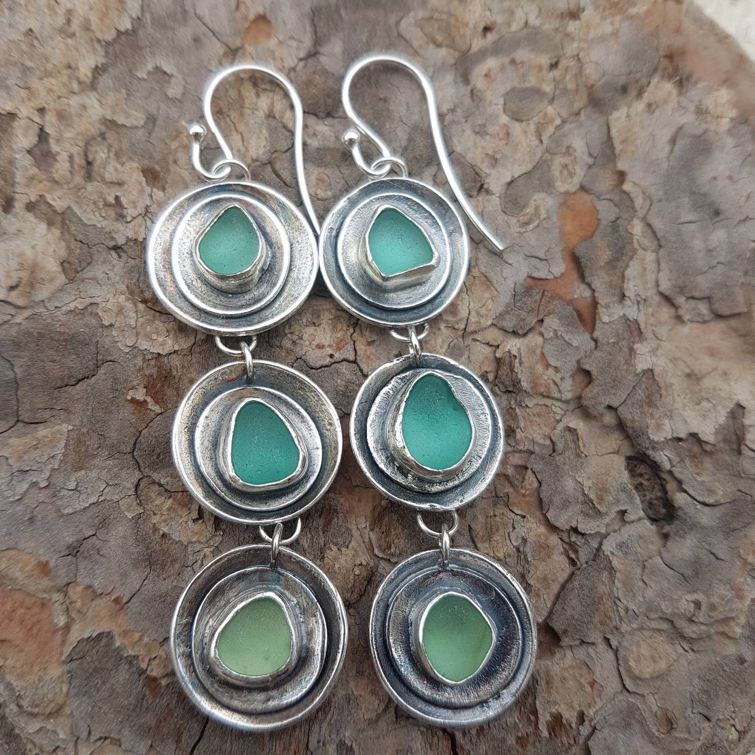 Photo of Handmade silver earrings with genuine sea glass. Fine silver clay jewelry.  Beach glass jewelry. Seaglass earrings. Long earrings with glass