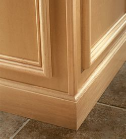 Cove Baseboard Molding Installed At Base Of Floor Cabinets At