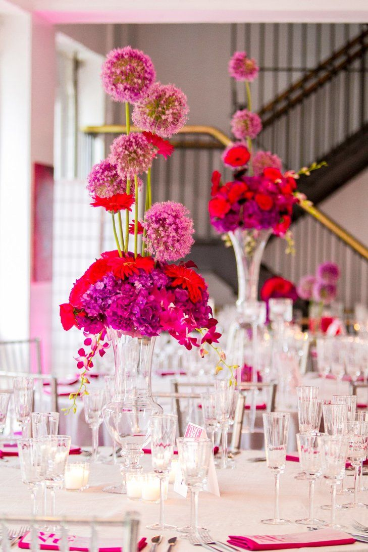 Purple and Fuchsia Centerpieces | Ron Soliman Photojournalism https://www.theknot.com/marketplace/ron-soliman-photojournalism-wilmington-de-254542 | Trust https://www.theknot.com/marketplace/trust-philadelphia-pa-279089
