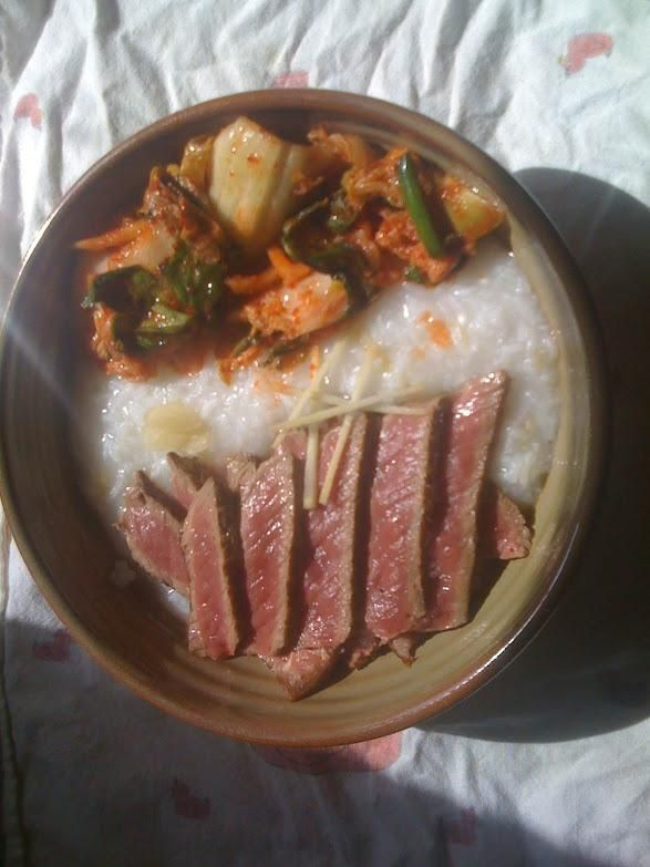 homemade rare beef sliced on congee with kimchi  i am
