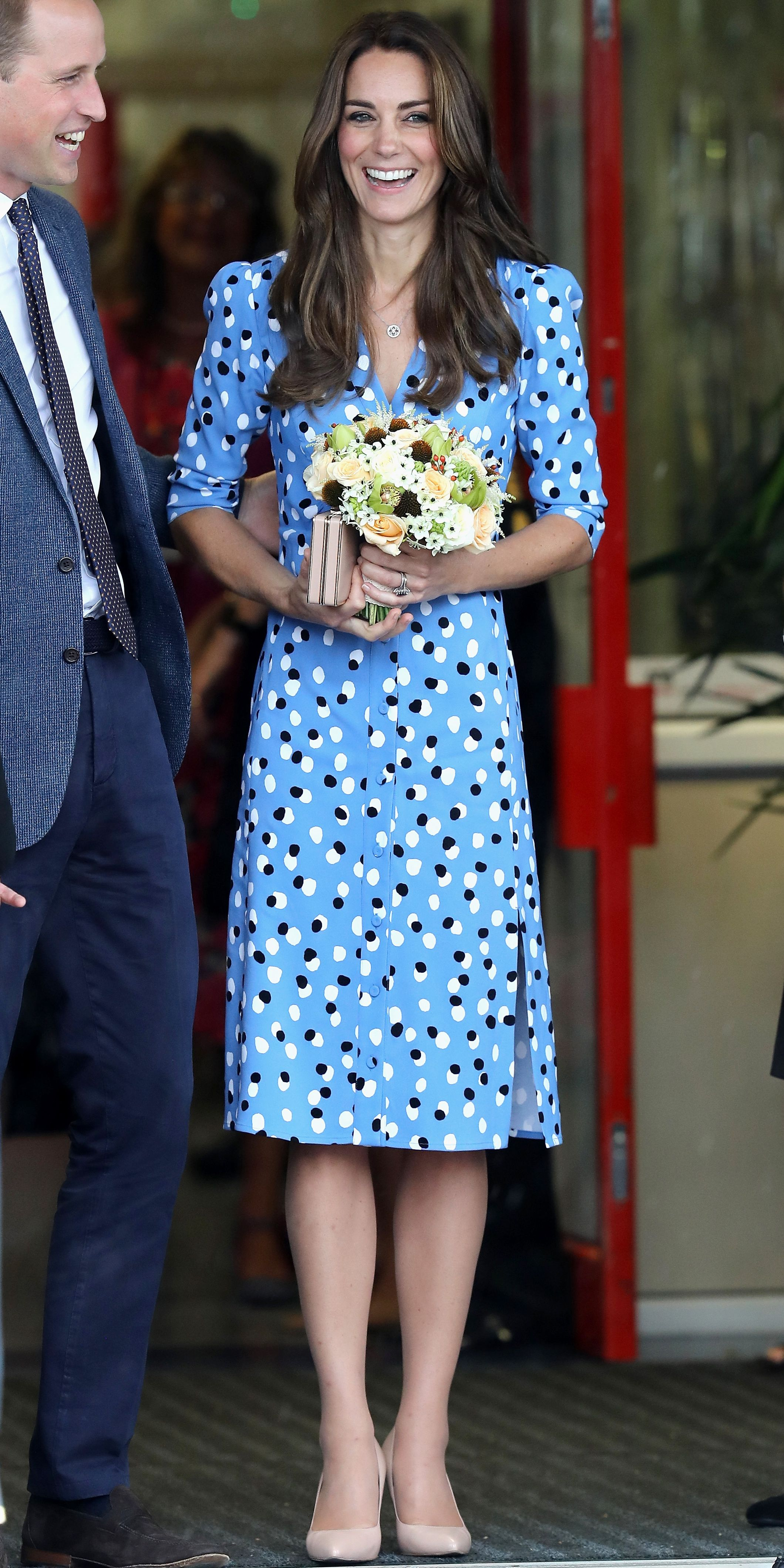 The Duchess stepped out in a blue polka-dot dress and nude pumps for a trip  to the Stewards Academy with Prince William. 365c283f0