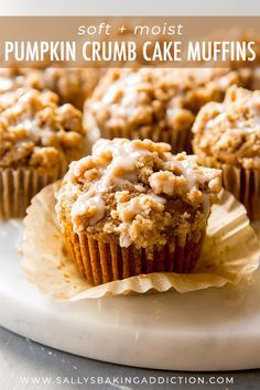 Soft and moist pumpkin muffins topped with pumpkin spice crumbs and maple icing! Recipe on sallysbakingaddiction.com #pumpkinmuffins
