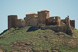 The Castle of Montearagón is a former fortress-monastery in Quicena, near Huesca, Aragon, Spain, built in the Romanesque style. It is presently in ruins.  In 1094 Sancho Ramirez reinforced the castle to help with the siege of the Muslim stronghold of Wasqah (Huesca); here he met his death by a stray arrow as he was reconnoitering the city's walls. The city was conquered in 1096 by Peter I of Aragon, after defeating the relief forces in the Battle of Alcoraz.
