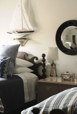 Some subtle features:  A porthole mirror and waves top the headboard.  Very nice.