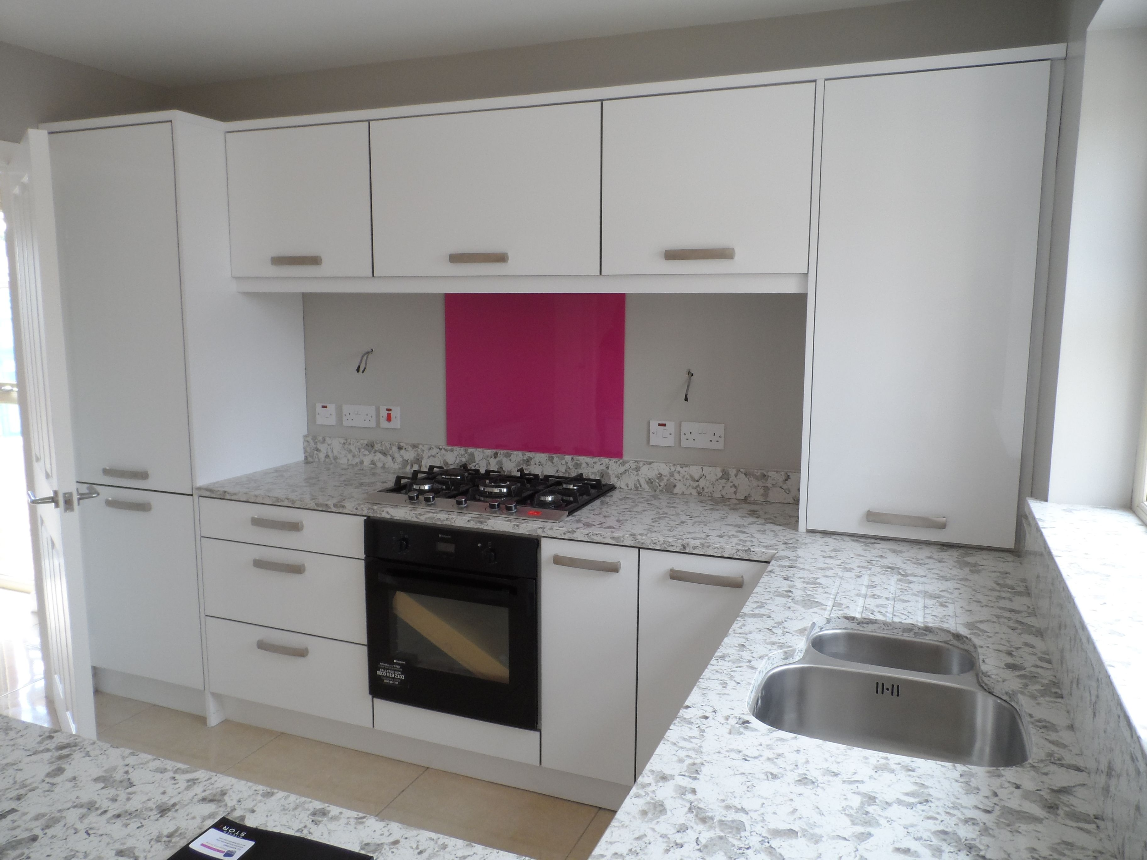 our show house kitchen with bespoke glass splashback giving that
