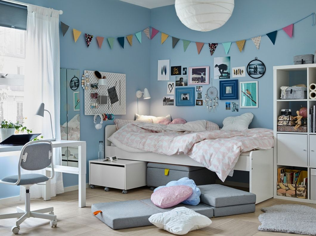 A Tween Bedroom With Blue Walls And A White Slakt Bed With Items Underneath Beside A Pahl Desk And Orfjall Ju Ikea Kids Bedroom Kids Bedroom Sets Tween Bedroom