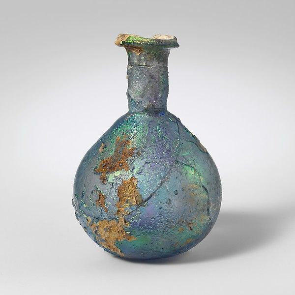 Glass perfume bottle Date: 1st century A.D. Culture: Roman Medium: Glass; blown and cut Dimensions: 3 1/8 in. (7.9 cm) Diameter: 2 1/4 x 7/8 in. (5.7 x 2.2 cm) Classification: Glass Credit Line: The Cesnola Collection, Purchased by subscription, 1874–76 Accession Number: 74.51.203