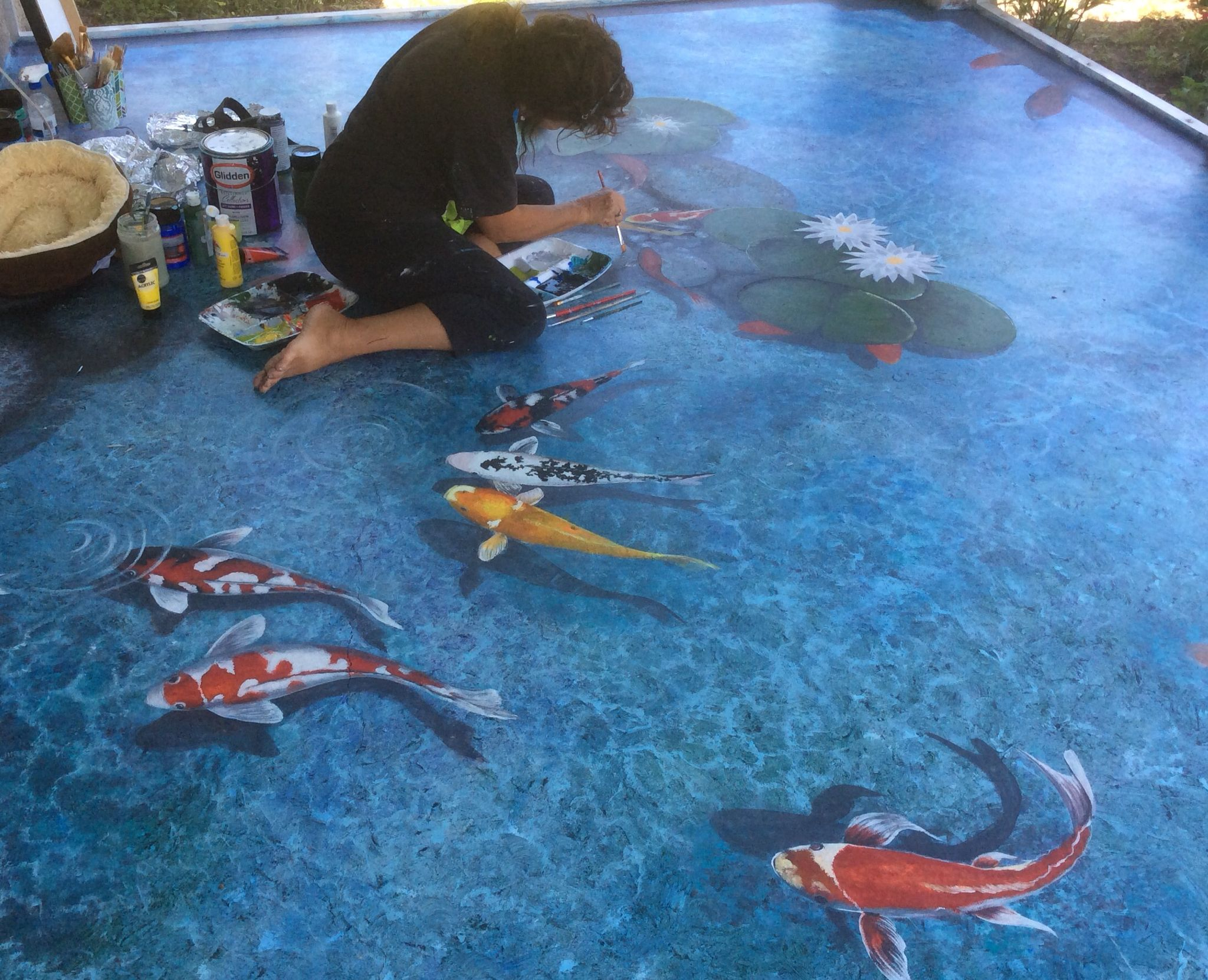 Painting floor using latex and acrylic.  Trompe l'oeil koi pond. Art and design by Louise Moorman.