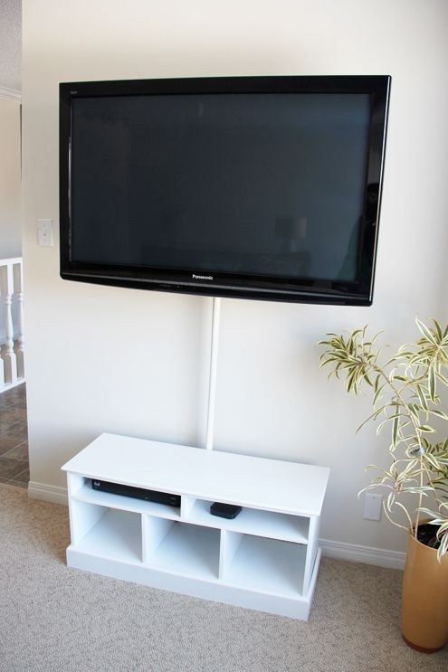 Hide Your Television Wires In A Shower Curtain Rod Home Home Upgrades Home Diy
