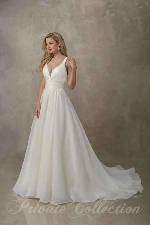 Float Down The Aisle In This Organza Wedding Gown A Modern Romantic