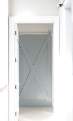Gray Barn Door in Laundry room. Gorgeous gray laundry room barn door on rails with polished nickel pull. #barndoor #laundryroom #graybarndoor #graydoor Churchill Design. #graylaundryrooms Gray Barn Door in Laundry room. Gorgeous gray laundry room barn door on rails with polished nickel pull. #barndoor #laundryroom #graybarndoor #graydoor Churchill Design. #graylaundryrooms Gray Barn Door in Laundry room. Gorgeous gray laundry room barn door on rails with polished nickel pull. #barndoor #laundryr #graylaundryrooms