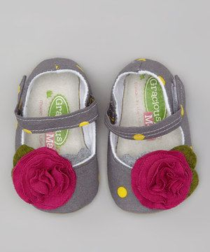 Tiptoeing between fashion and function, these mary janes have soft soles with skid-resistant bottoms and fasten effortlessly with a hook and loop closure. They're embellished with precious petals in a sweet palette of colors.