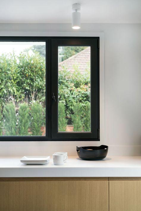 Minimalist Long Narrow Paris Kitchen With Indoor Outdoor