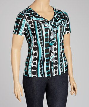 There's no such thing as too many tops! Fun and fresh, this top combines a ruffled fabric with a striking print.