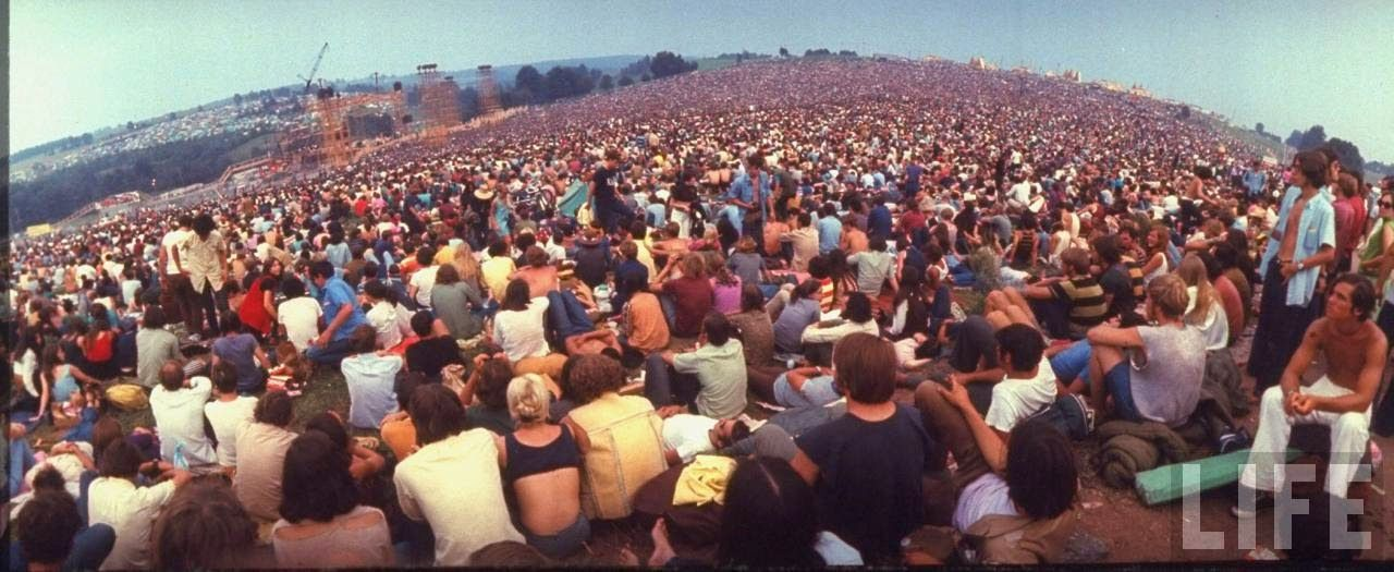 a look into woodstock music festival Woodstock was a music festival that took place in 1969 on a dairy farm in new york this event, attended by 400,000 people, is seen as an extremely pivotal movement in music history and the counter-culture generation.