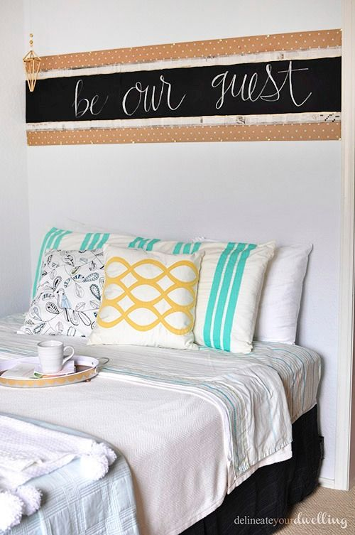This DIY chalkboard headboard will take your guest room from boring to beautiful!