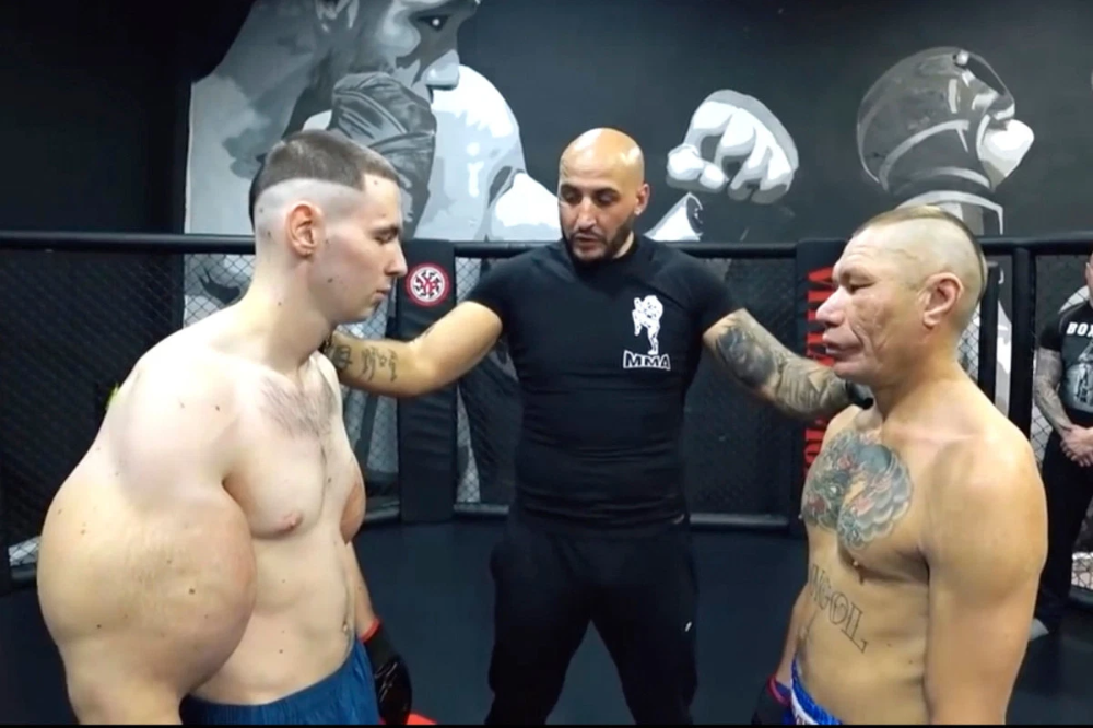 Russian showcases jaw-dropping foot wide biceps (VIDEO