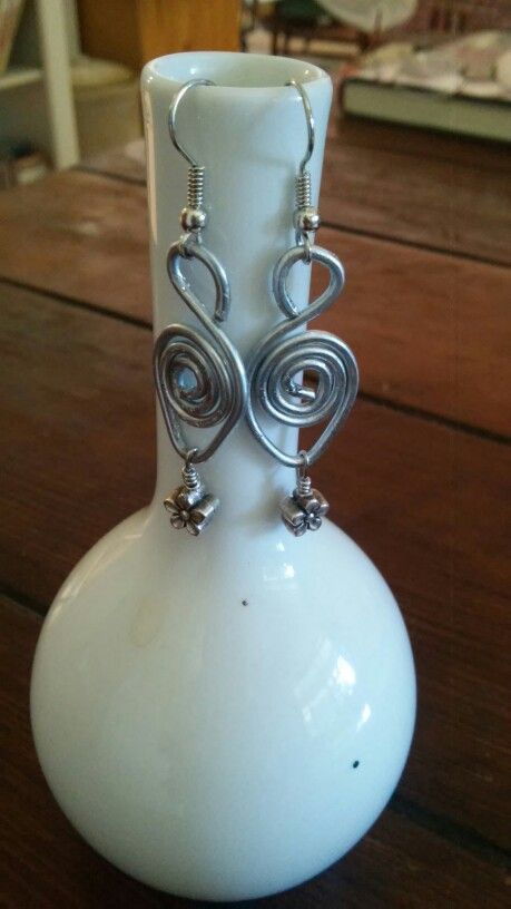 """Idea from """"making wire jewelry"""" by Linda Chandler and Christine Ritchey.  First earrings ive made!"""