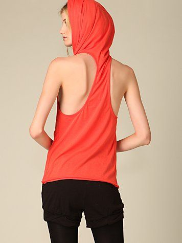 Free People RidinKnit tee with double layered hood. Racer back and rolled bottom hem. Snap detail on the center which can be closed on the front or back. Tee can be worn many different ways.