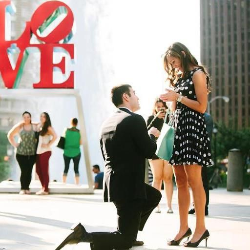 Choose a favorite place -- whether it's a fountain, hotel rooftop, monument or national park -- that has personal significance to the two of you. Once you're there, ask someone nearby to take a picture of you together, and instead of posing, drop down on one knee.
