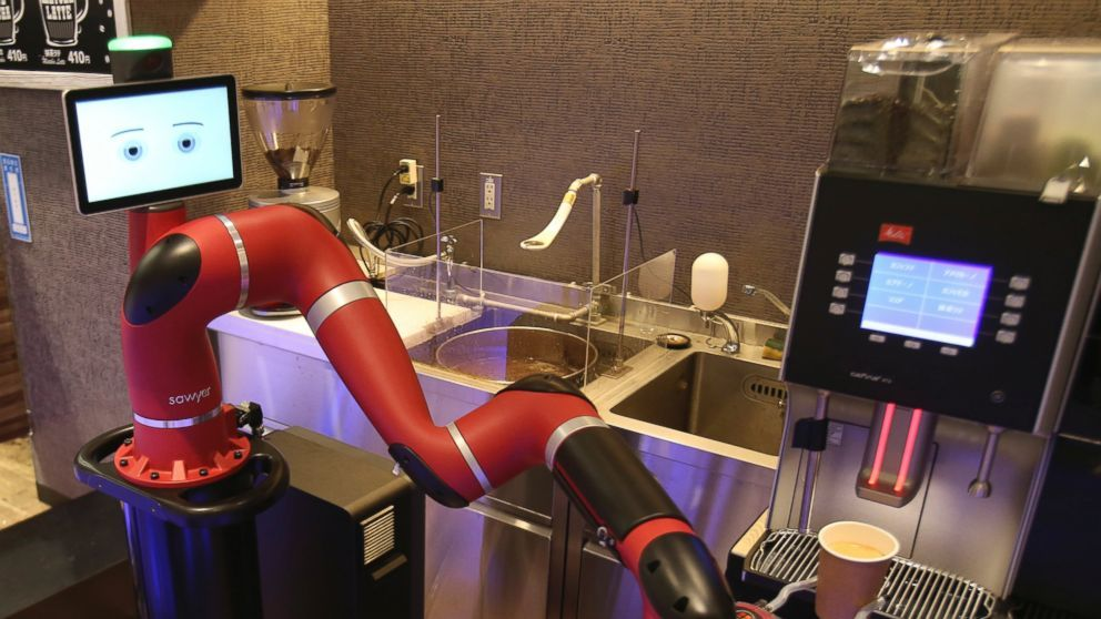 """Japan has a new robot cafe where customers can enjoy coffee brewed and served by a robot barista. The robot named Sawyer debuted this week at Henna Cafe in Tokyo's downtown business and shopping district of Shibuya. The shop's name in Japanese means """"strange cafe."""" The single-armed..."""