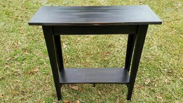 One of custom built console tables finished out in distressed black