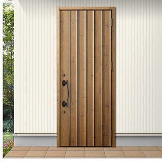 玄関ドア Lixil です 色はアイリッシュパイン 取手は黒