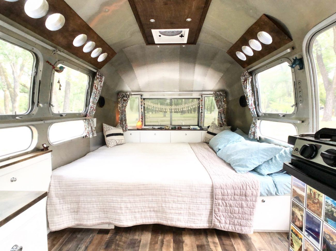 Airstream Dinette turned into bed. #airstreambed #airstream #airstreamrenovation #airstreamdreams #tinyhouse #tinyhouseonwheels #fulltimetravel | tinyshinyhome.com