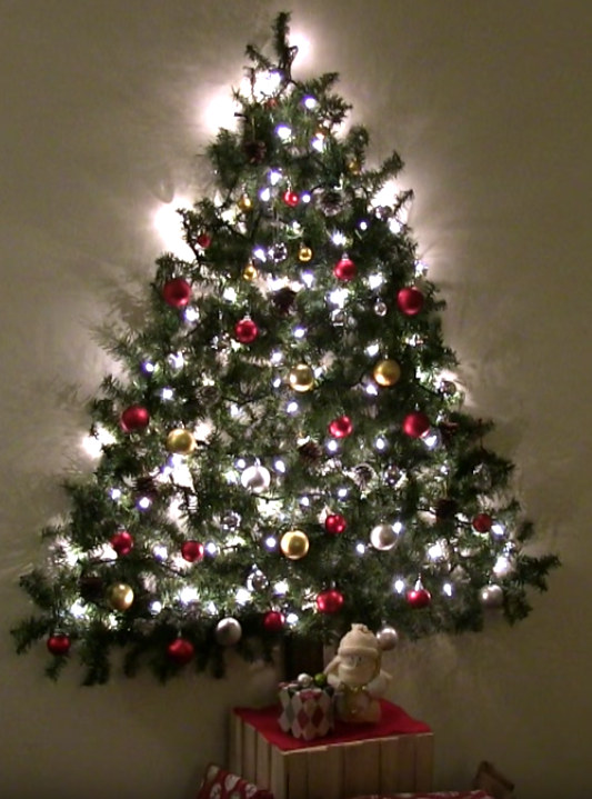 A Diy Wall Mounted Christmas Tree Is The Perfect Small Space Solution Wall Christmas Tree Wall Mounted Christmas Tree Flat Christmas Tree