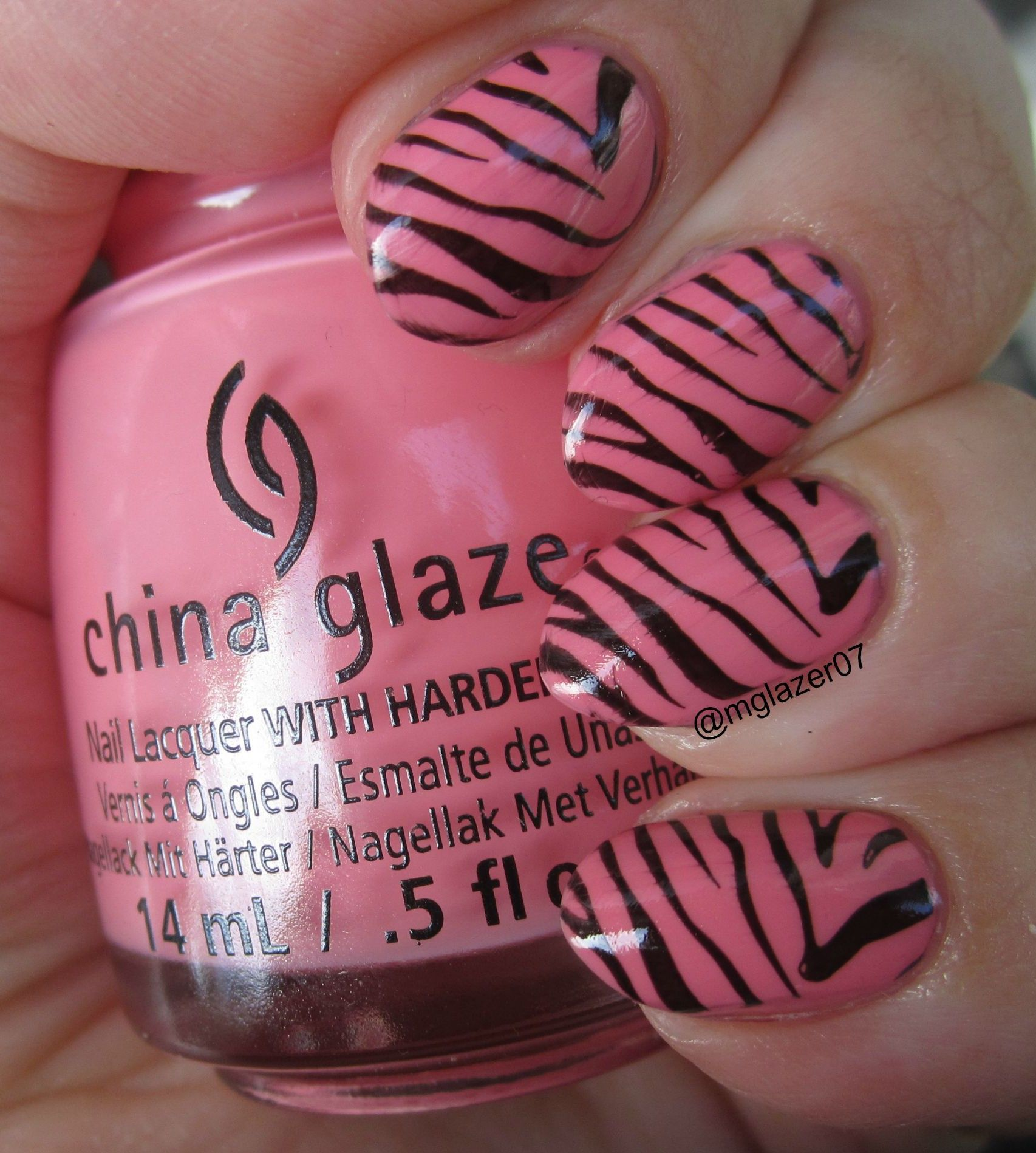 China Glaze  'Pinking Out the Window' and zebra stamping