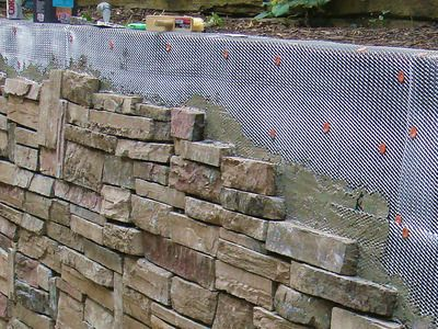 How To Cover A Stone Wall Railroad Tie Retaining Wall Diy Stone Wall Stone Wall