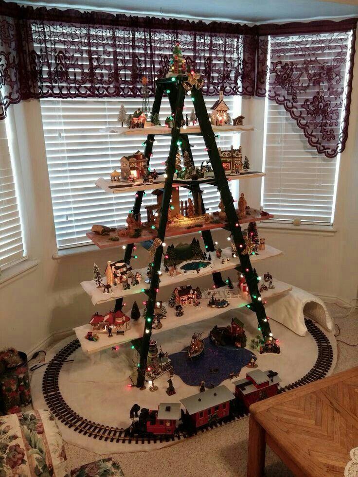 ladder and train! Disney Christmas items...   Christmas decor diy, Christmas tree village ...
