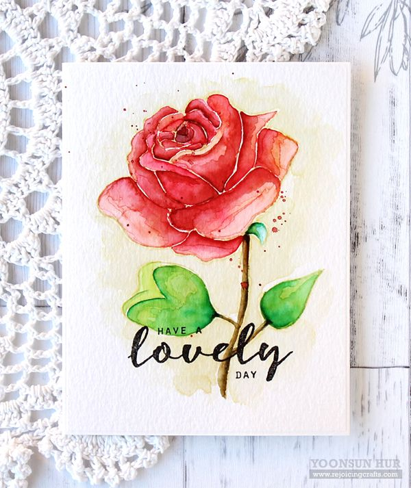 """I used no-line watercolouring technique. Stamped large sized rose from """"Graceful Rose"""" on an A2 sized watercolour paper panel in Antique Linen Distress ink. I then coloured w DISTRESS INKS using a Paint Brush: Petals: Festive Berries & Wild Honey Leaves: Mowed Lawn & Twisted Citron Sprig: Gathered Twigs & Vintage Photo. I added some red ink splatters, then stamped sentiment on bottom of watercoloured panel using VersaFine Onyx Black (7.6.16) (wc3, fav)"""