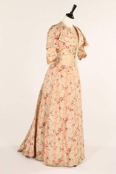 Lot 1 : A Russell & Allen pink and white printed floral silk Directoire-style gown with large moulded buttons to the faux waistcoat - c1900?. Estimate:£250 - £400