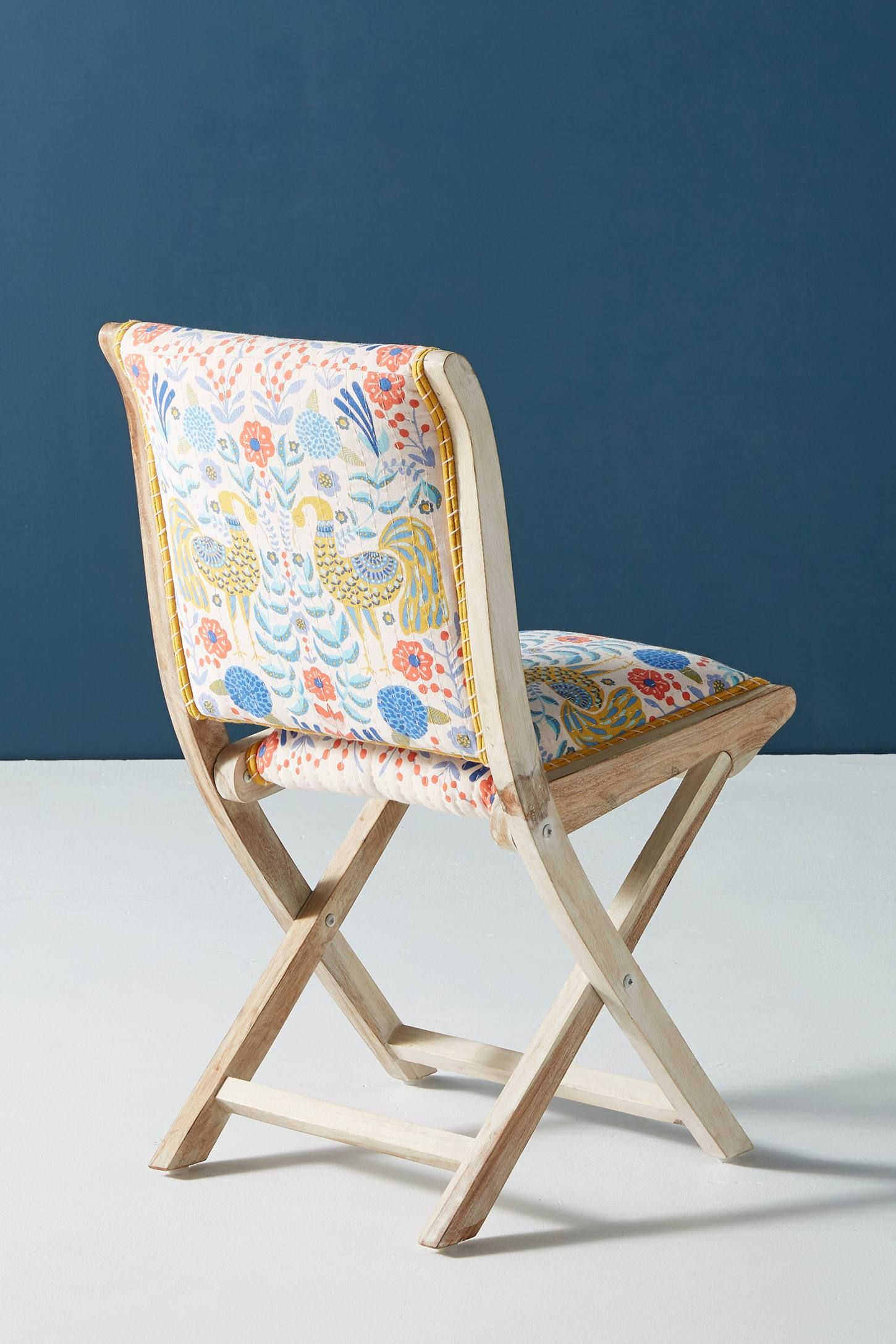 Jimena Terai Folding Chair is part of Folding dining chairs - Featuring a whimsical print in vividly bright hues, this statementmaking seat assures there's always room for one more     For ordering assistance and more, please contact us  For aesthetic advice and tips to help decorate your space, enjoy our complimentary home styling services