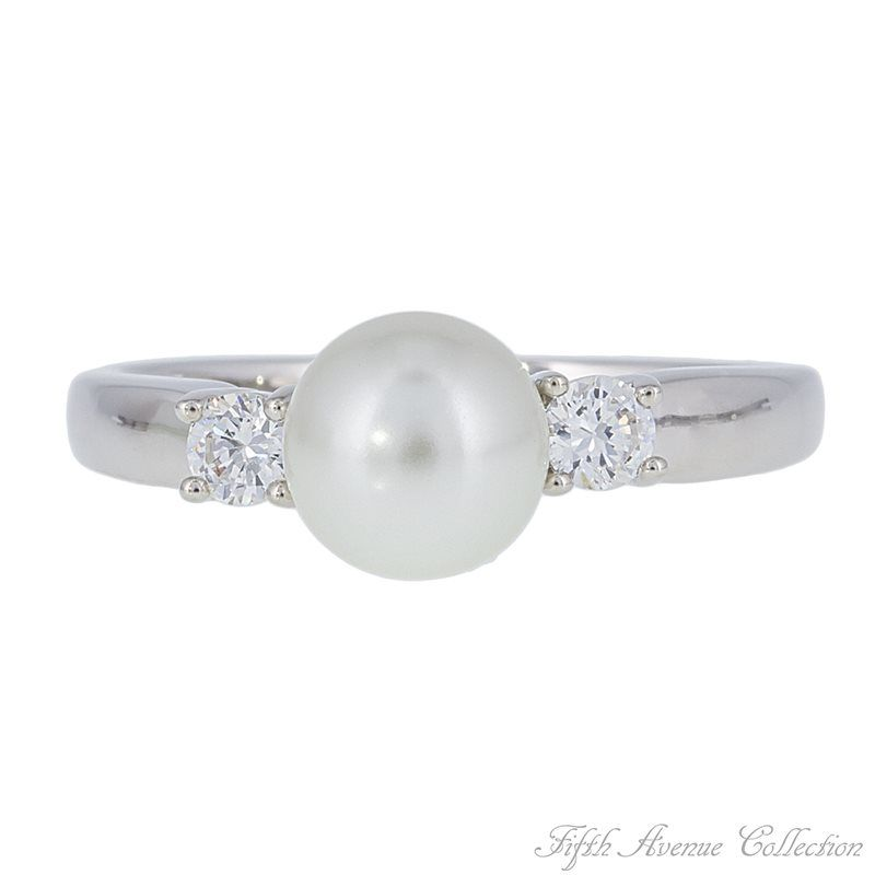 """Only """"In Your Dreams"""" will you find such a perfect fit for any woman's jewellery collection.  Whether your personal style is classic, romantic or casual, you are going to fall in love with this beguiling yet simple design. A single lustrous pearl crowned with two brilliant triple A quality cubic zirconia that come together in harmonious beauty on a smooth band finished in rich rhodium."""