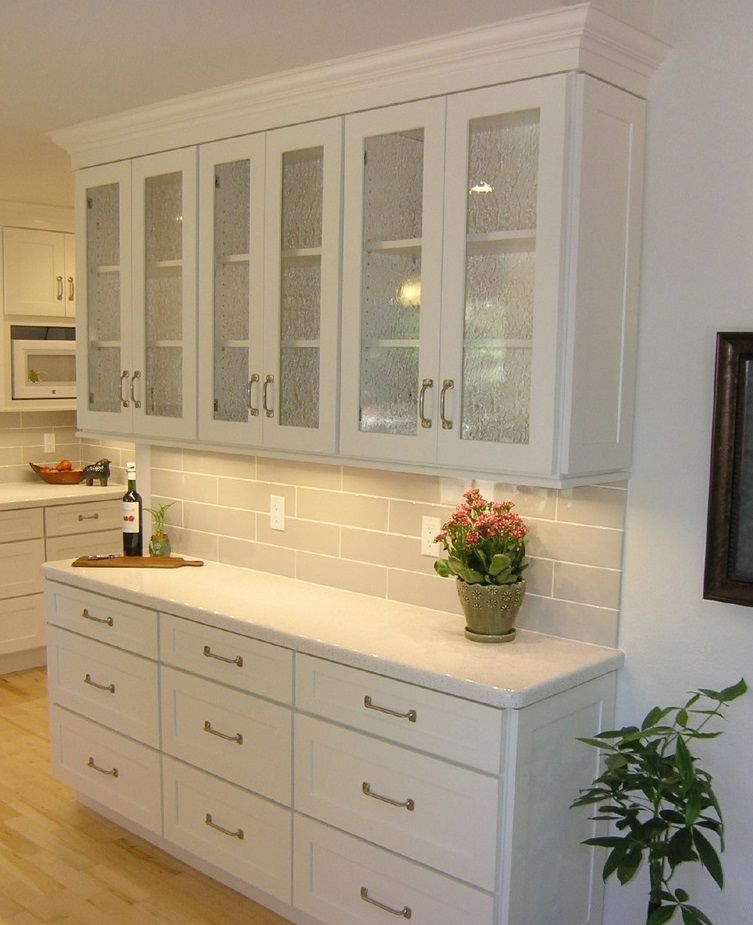 Shallow Buffet Built Of White Shaker Cabinets With Textured Gl Doors And Sash Pulls