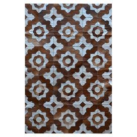 """""""fabric"""" for banquette in Nook.  Option.   joss & main. Patchwork Cowhide rug with a Moroccan tile motif.  Product: RugConstruction Material: CowhideColor: Brown and white Note: Size is approximate. Please be aware that actual colors may vary from those shown on your screen. Accent rugs may also not show the entire pattern that the corresponding area rugs have.Cleaning and Care: Clean with dry cloth"""