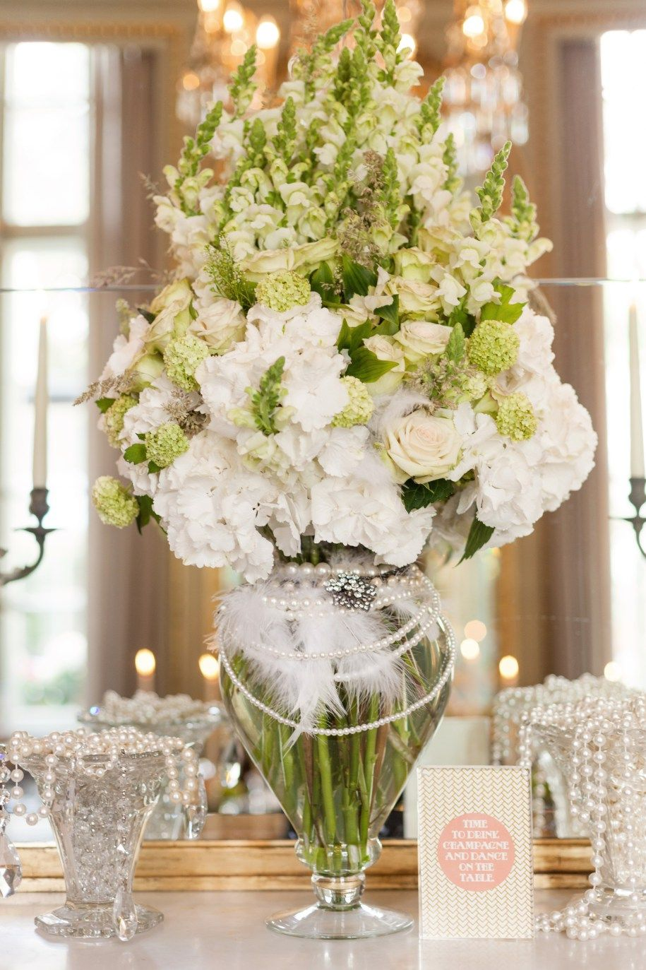 Wedding Flowers. A glorious bouquet for a foyer or entry into your event. Loads of white blooms with dainty soft green accents.