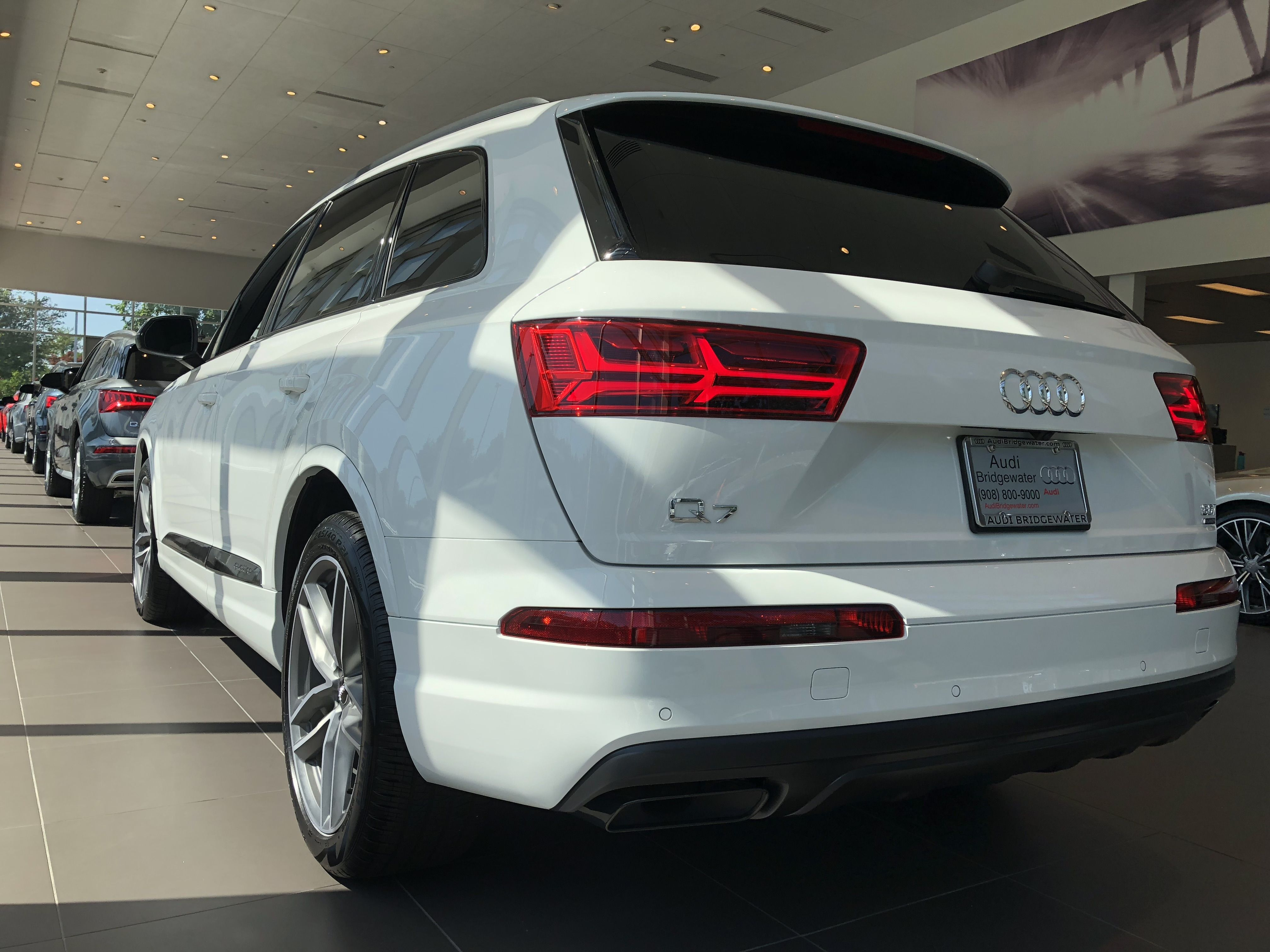 Rear Angled View Of The 2018 Audi Q7 In Carrara White Vehicle Available At Audi Of Bridgewater Nj Audi Dealership Audi Q7 Audi Q7 White