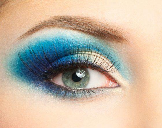 Macro shot of female eye with blue make up and long lashes