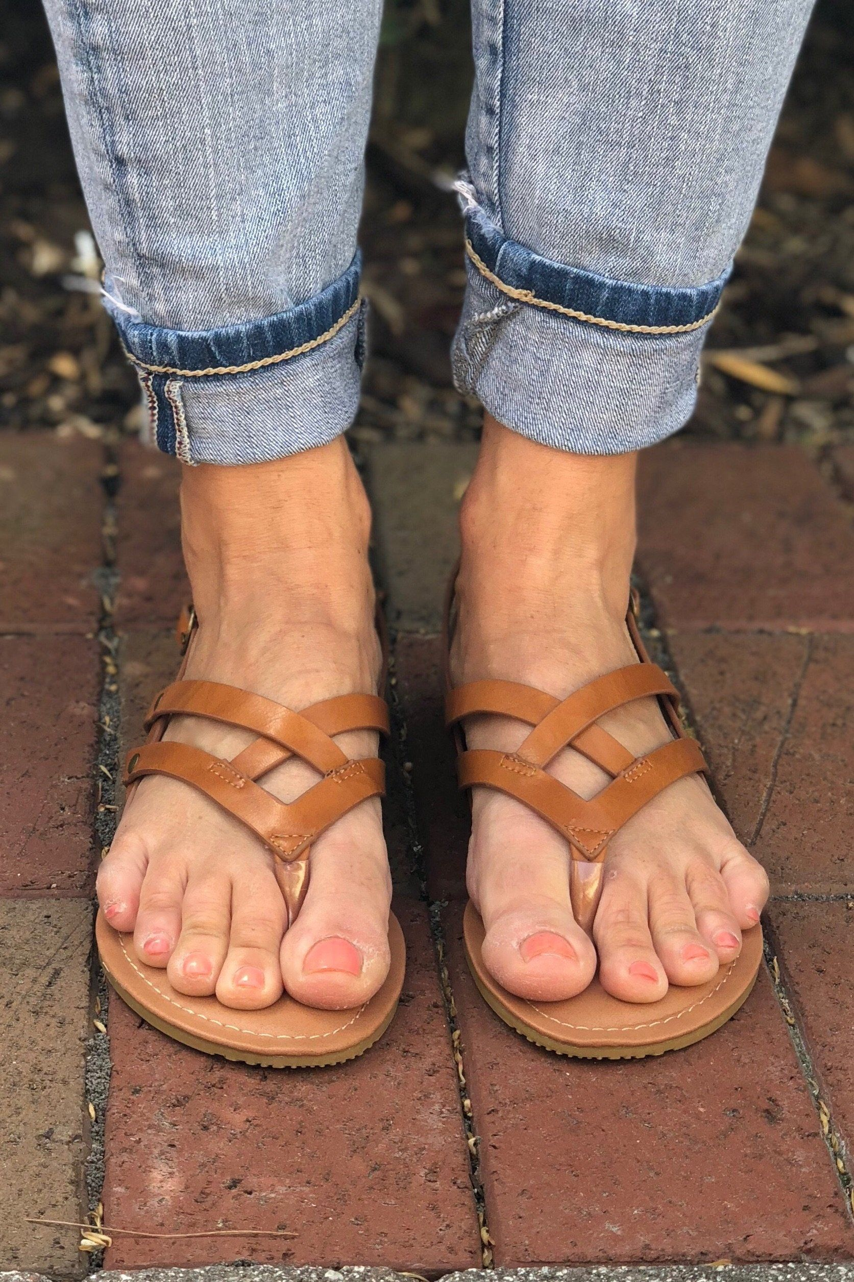 Tan sandal with double strap on the top of the foot and