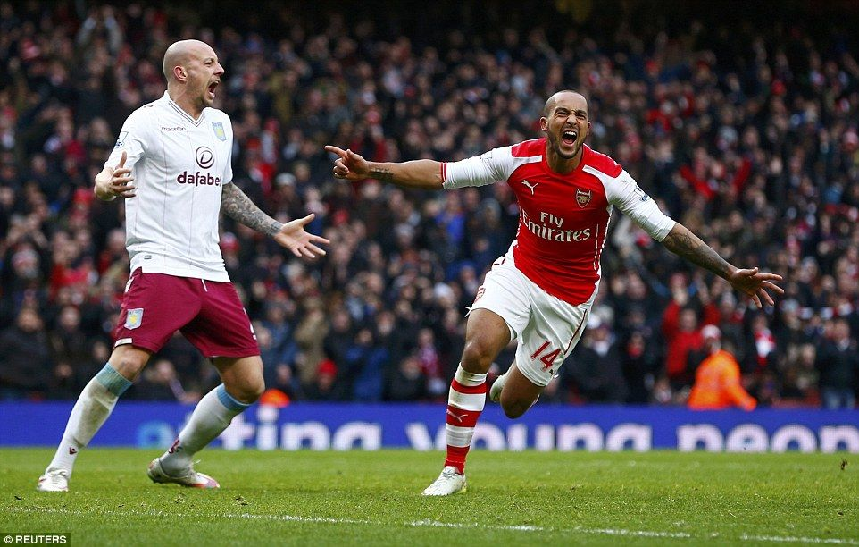Walcott celebrates scoring his first Premier League goal
