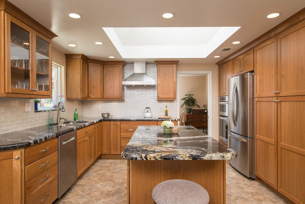 John Deluca Designed This Kitchen In Ramona California With Starmark Cabinetry S Bridgeport Door Style Brown Cabinets Kitchen Remodel Kitchen Cabinet Colors